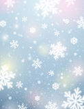 Light background with bokeh and blurred snowflakes, vector Stock Photography