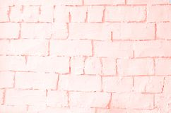 Light background with a brick wall of coral color royalty free stock photo
