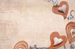 Light background with brown and beige hearts Stock Images