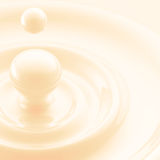 Light background: cream or milk liquid drop Royalty Free Stock Photography