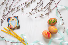 Light background with ikon of Jesus image, Church candles, Easte. R eggs and willow branches. Space for text Stock Photography