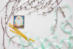 Light background with ikon of Jesus image, Church candles and wi. Llow branches. Space for text Royalty Free Stock Images