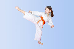 On a light background little athlete beat high leg kick Stock Images