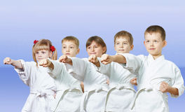 On a light background the little athletes beats punch arm Stock Photography