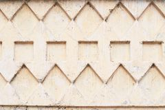 Light background. Relief on the wall. Squares and rhombus Royalty Free Stock Photography