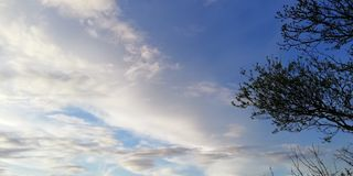 Light background. Unusual white clouds on a blue sky royalty free stock images