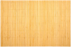 Light bamboo carpet. With beige sticks and threads Stock Images