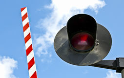 Light and barrier. Seen in a Railway level crossing Stock Image