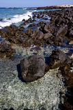 Light  beach water  in lanzarote  isle   rock spain    stone   c Royalty Free Stock Photos