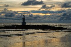 Light beacon. With dramatic clouds in the background Royalty Free Stock Images