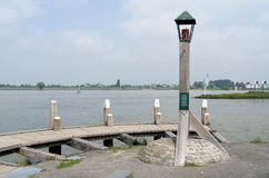 Light Beacon on the jetty in the river The Waal. Stock Photo