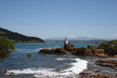 Light Beacon Knysna. With sea and rocks as foreground Royalty Free Stock Images