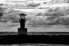 Light beacon at sunset BW. With dramatic clouds in the background Stock Photography