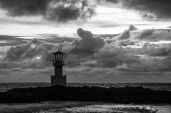 Light beacon at sunset BW. With dramatic clouds in the background Royalty Free Stock Photos
