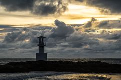 Light beacon at sunset. With dramatic clouds in the background Royalty Free Stock Image