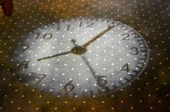 Light beam of a clock. On a lounge mat Stock Image