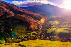 Light  beam falls on hillside with autumn forest in mountain Royalty Free Stock Photo