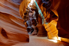 Light beam shining through the slot canyon. Colorful image of a sun light beam shining through the Upper Antelope slot Canyon Stock Photo