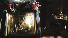 In light beam there is an icon with image of holy man with flowers. St. Nicholas. In light beam there is an icon with image of holy man with flowers. In temple stock footage