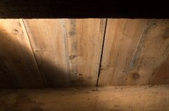 A light beam on the wooden background.  Royalty Free Stock Images