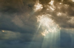 Light beams. Coming out from the clouds stock images