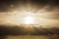 Light beams shining trough the clouds Royalty Free Stock Images