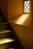 Light beams into a stairway Royalty Free Stock Images