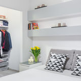 Light bedroom with wardrobe Royalty Free Stock Images