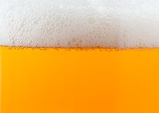 Light beer background with foam Stock Photos