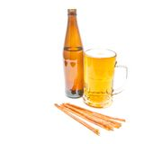 Light beer, bottle and fish snack on white Stock Photography