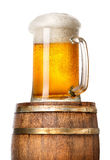 Light beer on cask. Isolated on a white background Royalty Free Stock Photos