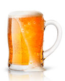 Light beer with foam in mug Stock Images