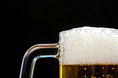 Light Beer in a glass pint mug served on a wooden stock photos