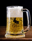 Light Beer in a glass pint mug served on a wooden stock images
