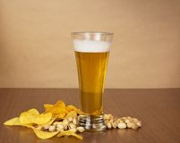 Light beer in glass with snack Stock Image