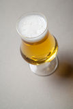 Light beer on gray Royalty Free Stock Image