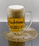 Light beer in the mug on wet surface Stock Photo