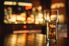 Light beer on a pub background. Glasses of light beer on a pub background Royalty Free Stock Images