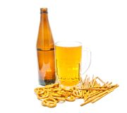 Light beer and salted crackers closeup. On white Stock Photography