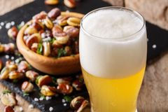 Light beer and a snack of crispy fried salted beans close-up. ho Royalty Free Stock Images