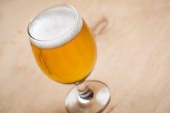 Light beer on wood Stock Photos