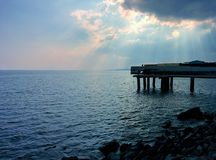 Seascape with light from begind clouds. Light from begind clouds Royalty Free Stock Photos