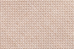 Light beige background of dense woven bagging fabric, closeup. Structure of the textile macro. Stock Photos
