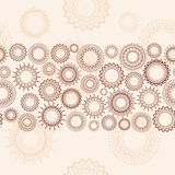 Light beige background. Light seamless pattern with ornamental wheels Stock Photo
