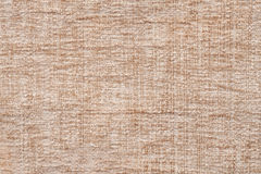 Light beige background of soft, fleecy cloth. Texture of textile closeup Stock Image