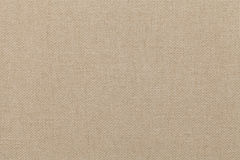 Light beige background from textile material. Fabric with natural texture. Stock Image