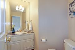 Light beige bathroom with built-in vanity cabinet royalty free stock photo