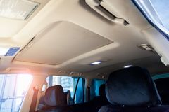 Light beige ceiling in the cabin of the SUV after dry cleaning and seasonal inspection in the workshop for repair and maintenance stock images