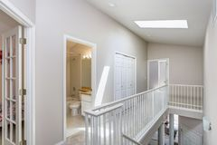 Light beige hallway with skylight. stock image