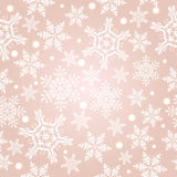 Light beige pattern with snowflakes royalty free stock photo